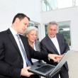 Senior couple visiting luxury villa with real-estate agent — Stock Photo
