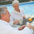 Senior couple having breakfast — Stock Photo