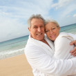 Senior couple at the beach — Stock Photo #6700426