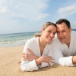 Couple relaxing at the beach — Stock Photo #6700473