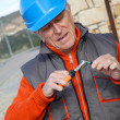 Worker installing gate system — Stock Photo