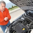 Senior man checking car motor levels — Stock Photo