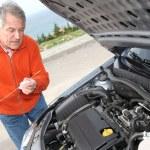 Senior man checking car motor levels — Stock Photo
