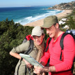 Couple looking at map on a hiking day — Stock Photo #6700760