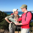 Couple looking at map on a hiking day — Stock Photo
