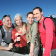 Stock Photo: Portrait of happy group of hikers