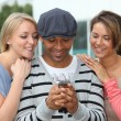 Group of friends with mobile phone — Stock Photo