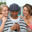 Group of friends with mobile phone — Stock Photo #6701134