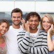Group of friends with telephone — Stock Photo