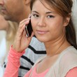Stock Photo: Beautiful young womwith phone