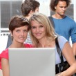 Royalty-Free Stock Photo: Students at college campus with laptop computer