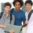 Group of students with laptop computer — Stock Photo