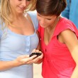 Young women with mobile phone at college campus - Foto de Stock