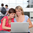 Students with laptop computer — Stock Photo