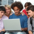 Stock Photo: Group of student with laptop computer