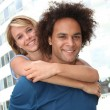 Young couple doing piggyback outside — Stock Photo
