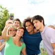 Group of friends taking picture with mobile phone — Stock Photo #6701730