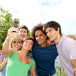 Group of friends taking picture with mobile phone — Stock Photo
