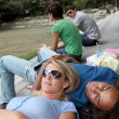 Students resting in park — Stock Photo