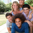 Group of happy students in a park — Stock Photo #6701863