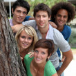 Group of happy students in a park — Stock Photo #6701870
