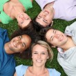 Group of friends laying down in park — Stock Photo #6701876
