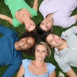 Group of friends laying down in park — Stock Photo #6701878