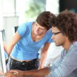 Young adults working on computer — Stock Photo