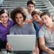 Group of college students with laptop computer — Stock Photo