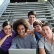 Group of college students with laptop computer — Stock Photo #6702269