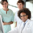 Doctor and nurses in a meeting - Stock Photo