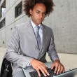 Young businessman working oustide the office — Stock Photo