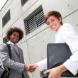 Salespeople shaking hands — Stock Photo