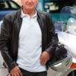 Senior man with motorcycle — Stock Photo