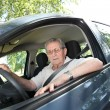 Elderly person driving a car — Stock Photo