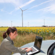 Agronomist with computer in field — Stock Photo