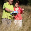 Senior couple rambling in countryside — Stock Photo #6703024