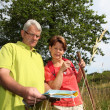 Senior couple rambling in countryside — Stock Photo #6703028