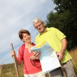 Stock Photo: Senior couple rambling in countryside