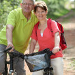 Senior couple riding bicycle in countryside — Stock Photo #6703050