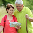 Senior couple rambling in countryside — Stock Photo