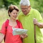 Senior couple rambling in countryside — Stock Photo