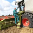 Man climbing on harvesting machine — Stock Photo #6703120