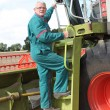 Man climbing on harvesting machine — Stock Photo #6703121