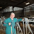 Breeder standing in barn — Stock Photo