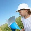 Little girl with blue wind wheel — Stock Photo