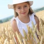 Little girl in wheat field — Stock Photo #6703243