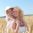 Mother and child in wheat field — Stock Photo