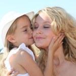 Little girl kissing her mom — Stock Photo