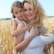 Mother and child with bowl of cereals — Stock Photo